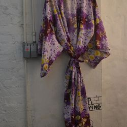 The kimonos are gorgeous, but they're on the more expensive side — to get this purple and yellow floral one, it'll cost you $218.