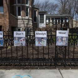 Hanging on the fence of a home a message of thanks to the essential workers working on the front lines of the coronavirus pandemic, in the 1300 block of West Bryn Mawr Avenue in the Edgewater neighborhood, Monday, April 6, 2020.