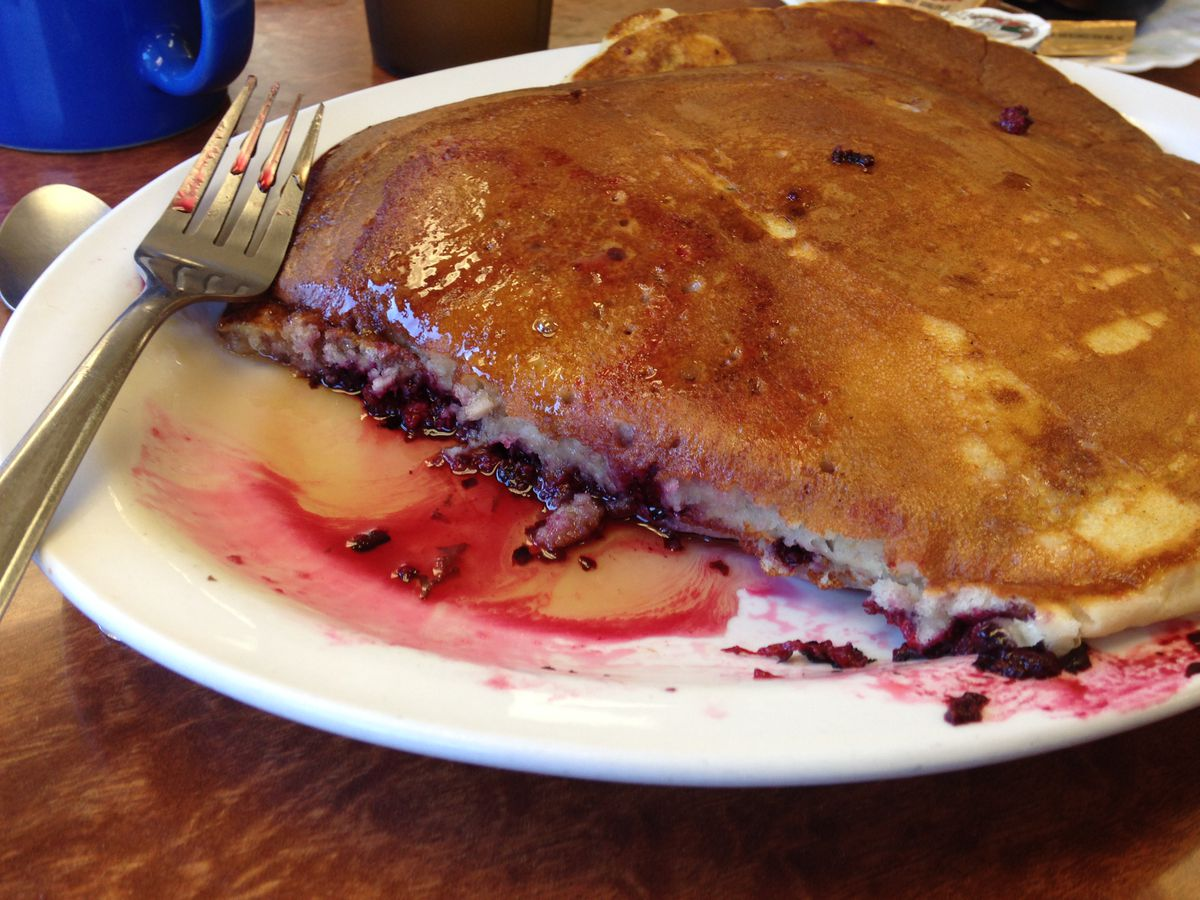 A partially eaten fruit-filled pancake at Blackberry Cafe in Port Angeles