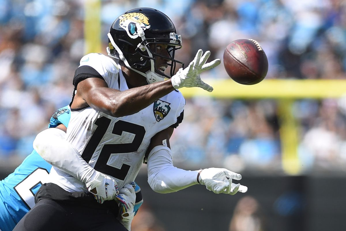Jacksonville Jaguars wide receiver Dede Westbrook pitches the ball to running back Leonard Fournette as he is being tackled by Carolina Panthers cornerback Javien Elliott in the second quarter at Bank of America Stadium.