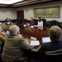 U.S. Secretary of the Interior Sally Jewell, back left, meets with the Deseret Media Companies Editorial Board in Salt Lake City, Wednesday, Aug. 5, 2015. At back right is Sarah Greenberger, senior adviser, U.S. Department of the Interior.