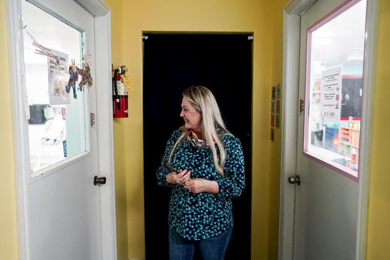 Linda Sego, owner of Sunshine Academy Preschool & Daycare in Alpine, looks in on some of the children at the center on Thursday, May 14, 2020. Sunshine Academy is one of several child care centers that have been approved to reopen, with a number of strict new operating guidelines, to serve the children of essential workers during the COVID-19 pandemic.