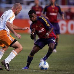 Real's Robbie Findlay cuts back from Dynamo's Craig Waibel during Real Salt Lake's match against the Houston Dynamo at Rice-Eccles Stadium in Salt Lake City, UT on Saturday, August 4, 2007. Photo by Kristin Nichols / Deseret Morning News