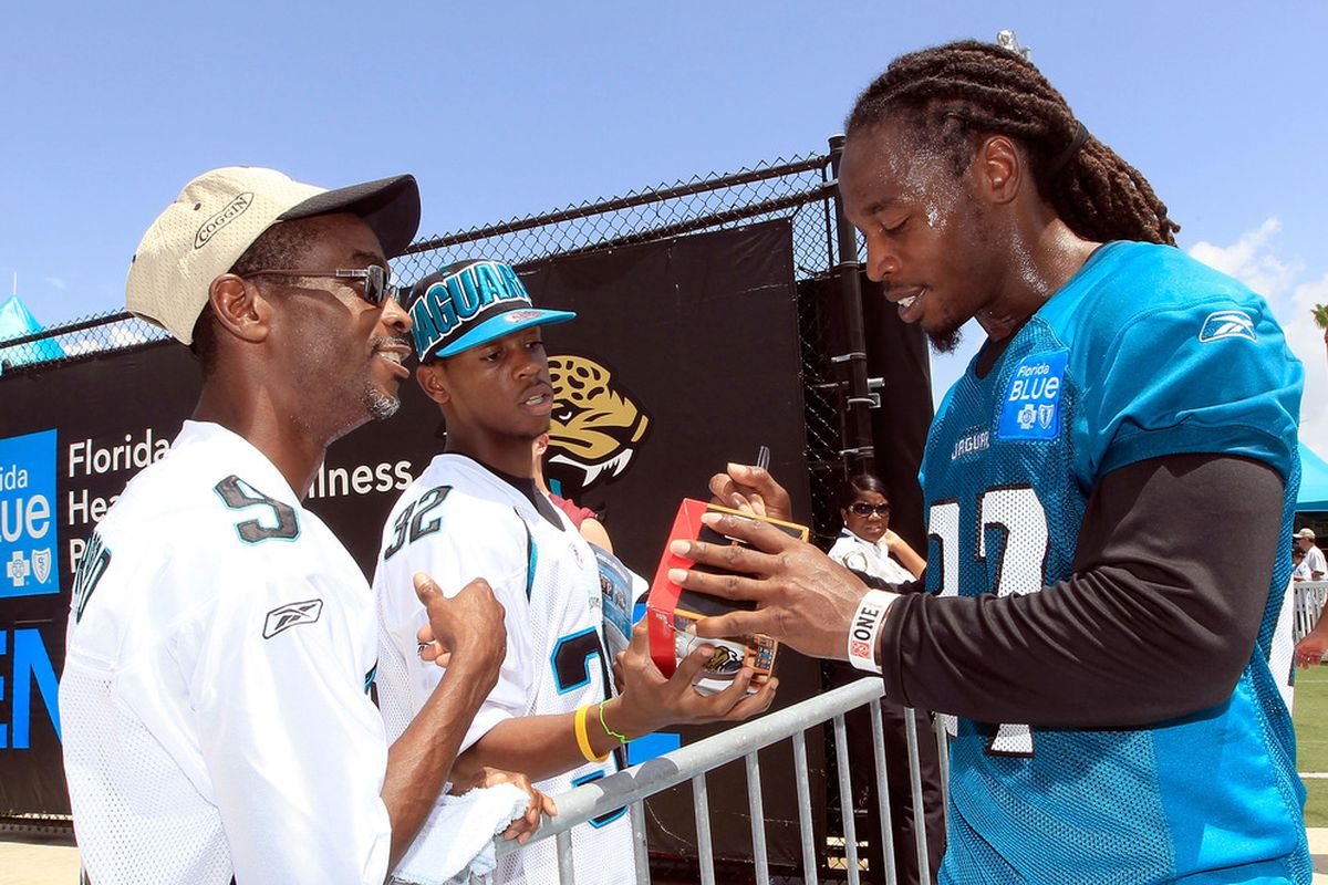 JACKSONVILLE, FL - JULY 28:  Rashean Mathis #27 of the Jacksonville Jaguars signs autographs following training camp at Florida Blue Health and Wellness practice fields on July 28, 2011 in Jacksonville, Florida.  (Photo by Sam Greenwood/Getty Images)