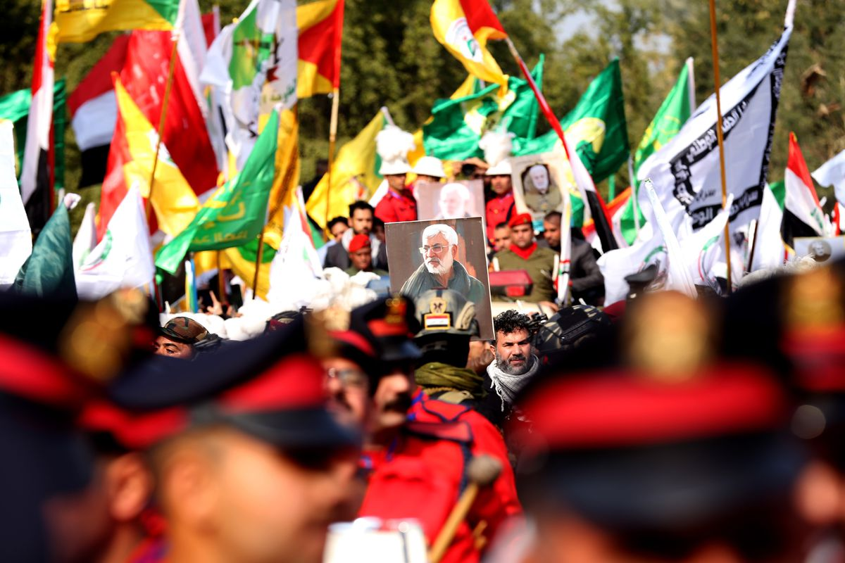 Mounters carry Iraqi, Iranian, and militia flags as well as portraits of the killed leaders in Baghdad.