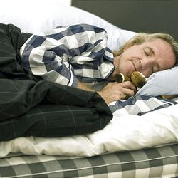 Greg Hardesty gets some beauty sleep on a luxury bed at Hastens in Newport Beach, California, July 24, 2009. The bed is one of several models hand made in Sweden with natural materials.