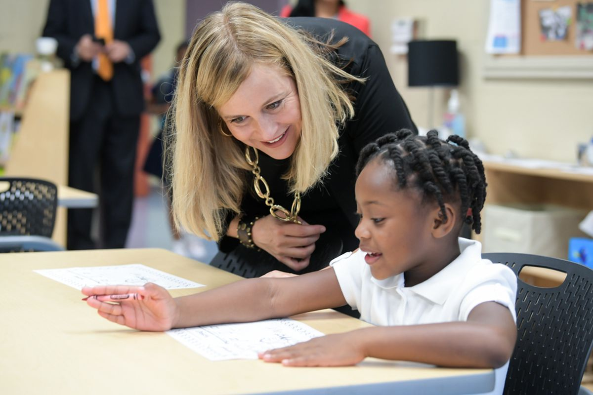 Nashville Mayor Megan Barry visits with a student at Buena Vista Elementary School on Monday, her first day back to work after the death of her only son to a drug overdose.