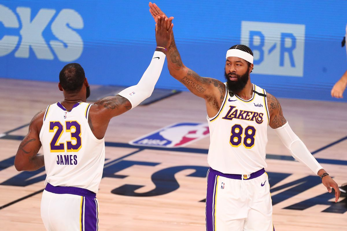 Los Angeles Lakers forward Markieff Morris celebrates with forward LeBron James during the second half of game three in the second round of the 2020 NBA Playoffs against the Houston Rockets at AdventHealth Arena.