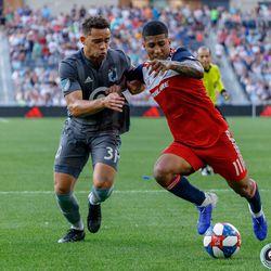 July 13, 2019 - Saint Paul, Minnesota, United States - Minnesota United midfielder Hassani Dotson (31) marks FC Dallas midfielder Santiago Mosquera (11) during the match at Allianz Field.