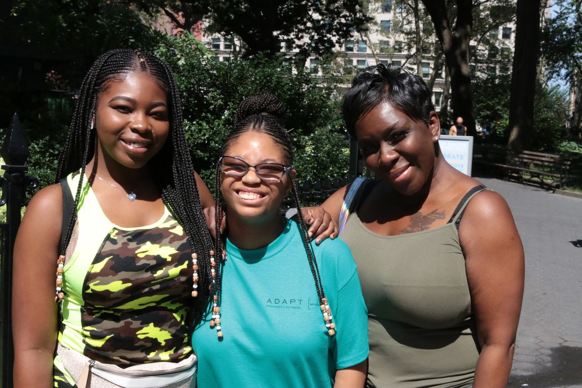 Amber Harris (center) attended the parade with her mother (right) and sister.