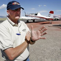 """Wayne Faw, above, a pilot for New Frontier Aviation, talks about how fighting fires from the air. """"It's a thrill a minute, followed by hours of boredom."""""""