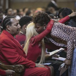 """Supporters hug the family of Bettie Jones, who was """"accidentally"""" shot by a Chicago Police officer the day after Christmas, during her funeral services at New Mount Pilgrim Missionary Baptist Church on Wednesday, Jan. 6, 2016."""