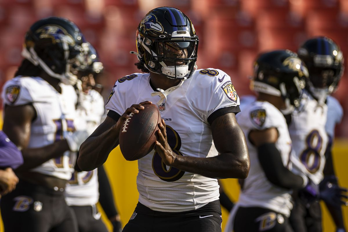 Lamar Jackson #8 of the Baltimore Ravens warms up before the preseason game against the Washington Football Team at FedExField on August 28, 2021 in Landover, Maryland.