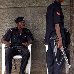 Nigerian police stand guard outside a church where people prayed for peace in the region after violence in recent days in  Maiduguri, Nigeria, Sunday,.