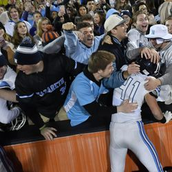 Nazareth fans hug players after winning the Class 7A state championship. Worsom Robinson/For the Sun-Times.