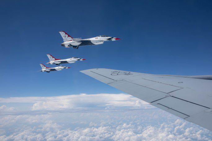 Thunderbirds fly alongside the KC-135 Stratotanker en route over Chicago on August 16, 2018. I Maria de la Guardia/Sun-Times