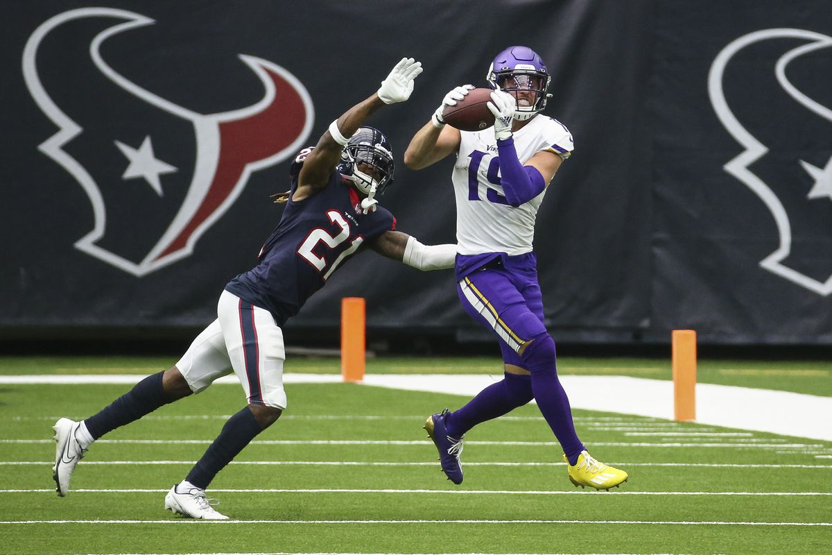 Minnesota Vikings wide receiver Adam Thielen (19) makes a reception against Houston Texans cornerback Bradley Roby (21) during the second quarter at NRG Stadium.