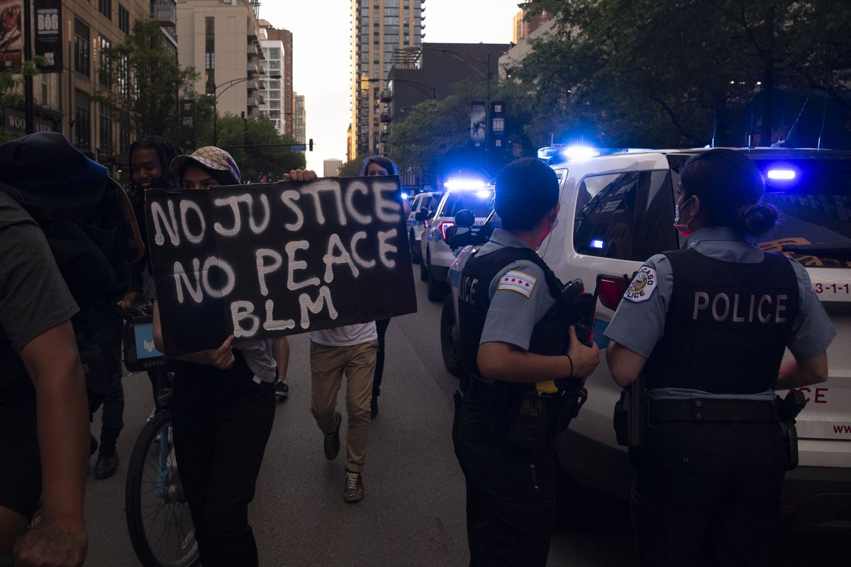 Hundreds of protesters demanding justice for George Floyd march around in Chicago's River North neighborhood, Friday, May 29, 2020.