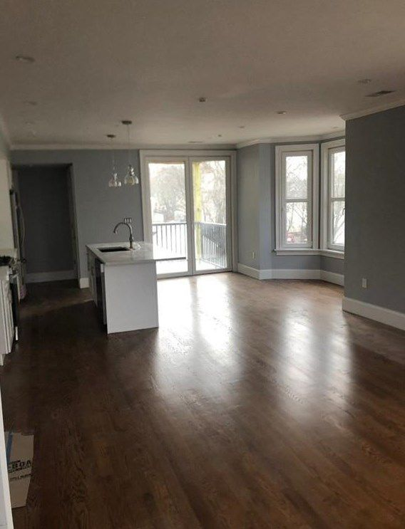 An empty, open kitchen-dining room area.