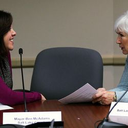 Shaleane Gee, left, and Gail Miller talk before a Collective Impact on Homelessness Steering Committee meeting at the Salt Lake County Government Center in Salt Lake City on Wednesday, Dec. 9, 2015.
