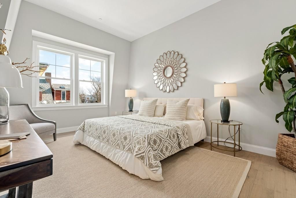 A bedroom with a bed and other furniture.