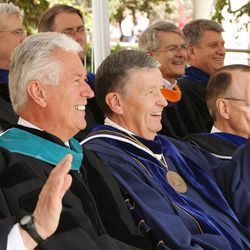 President Dieter F. Uchtdorf, second counselor in the First Presidency of The Church of Jesus Christ of Latter-day Saints, and President Cecil Samuelson wave to graduates during BYU Spring 2014 Commencement exercises in Provo Thursday, April 24, 2014.