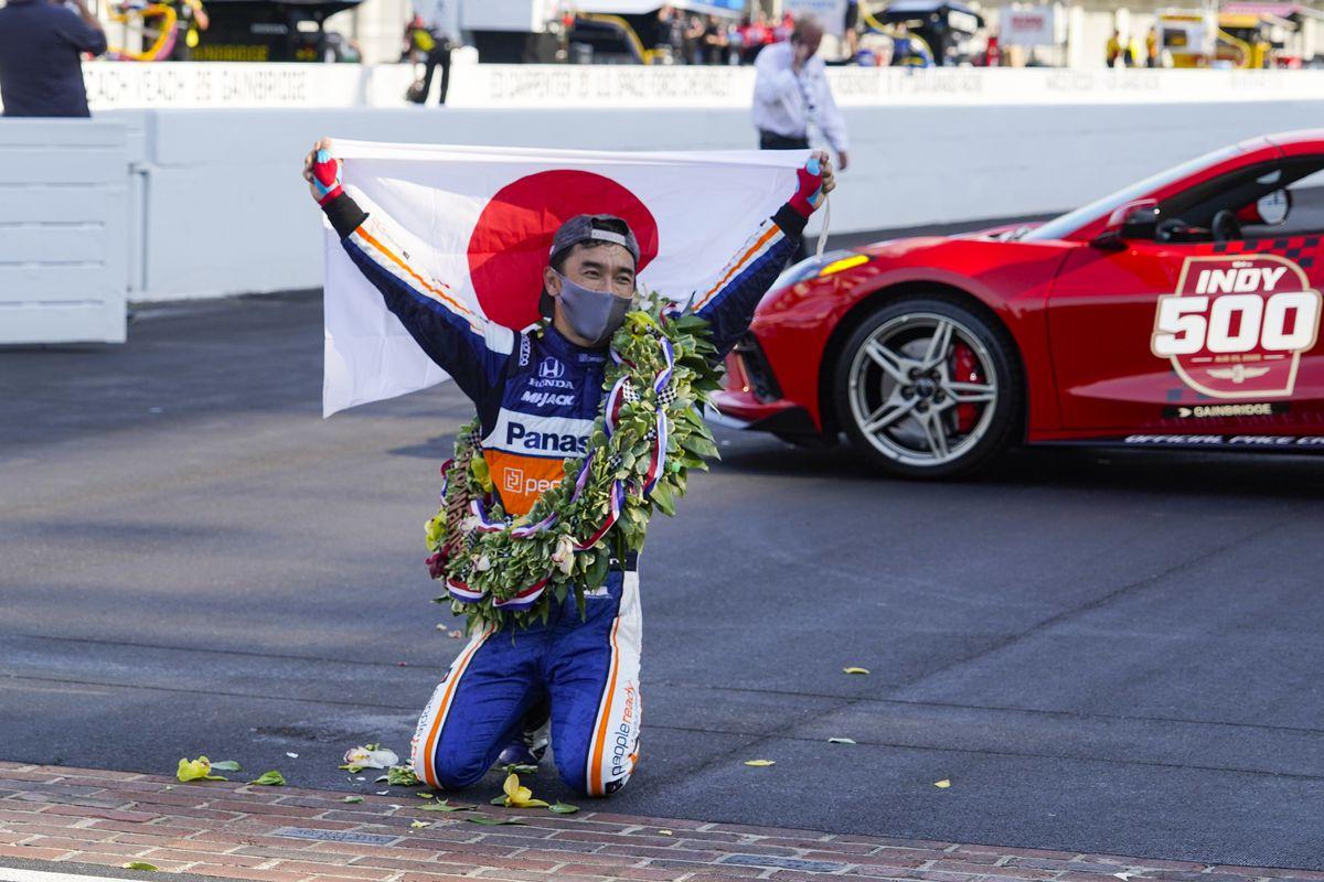 Takuma Sato celebrates after winning the Indianapolis 500.