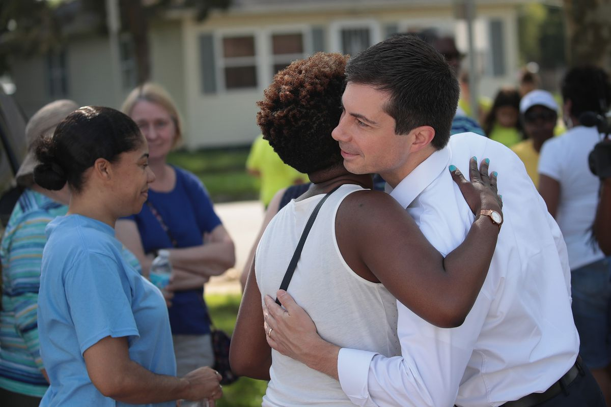 Democratic presidential candidate Pete Buttigieg gives a constituent a hug.