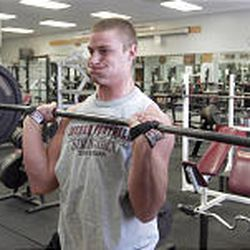 Jordan High School football player Cody Larsen lifts weights at the school's weight room. In two years, he gained 55 pounds.