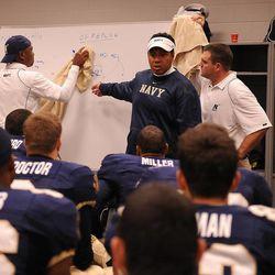 Navy head football coach Ken Niumatalolo talks to his team at halftime of a game.