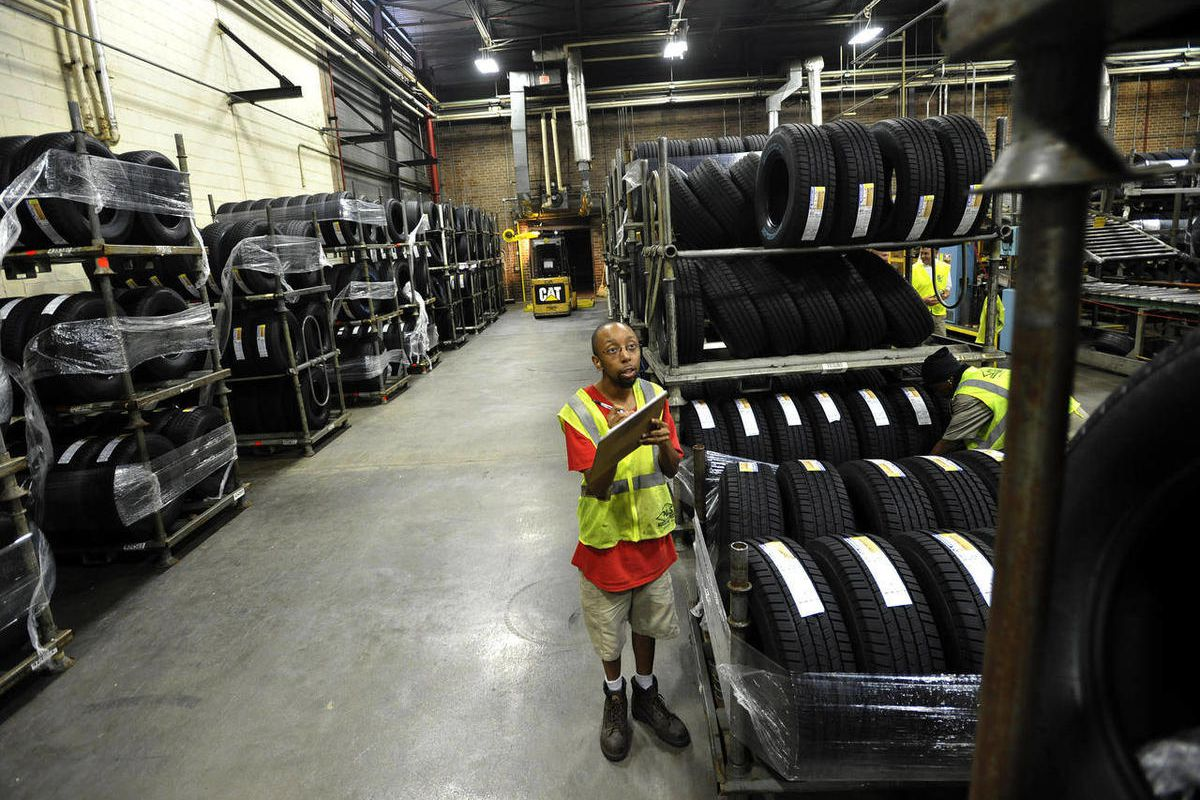 In this Tuesday, July 24, 2012 photo, forklift driver Clyde Boyce takes inventory in the warehouse at a Michelin tire manufacturing plant in Greenville, S.C.