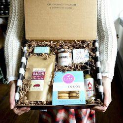 """South End artisan shop <b><a href=""""http://www.olivesandgrace.com/gift-box/"""">Olives & Grace</a></b> has built a reputation for crafting custom gift boxes using eco-friendly filler and its signature black and white striped paper—all tucked into myster"""