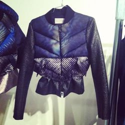 Peter Pilotto's futuristic twist on the classic puffer. Note the sleeves with laminated coating.