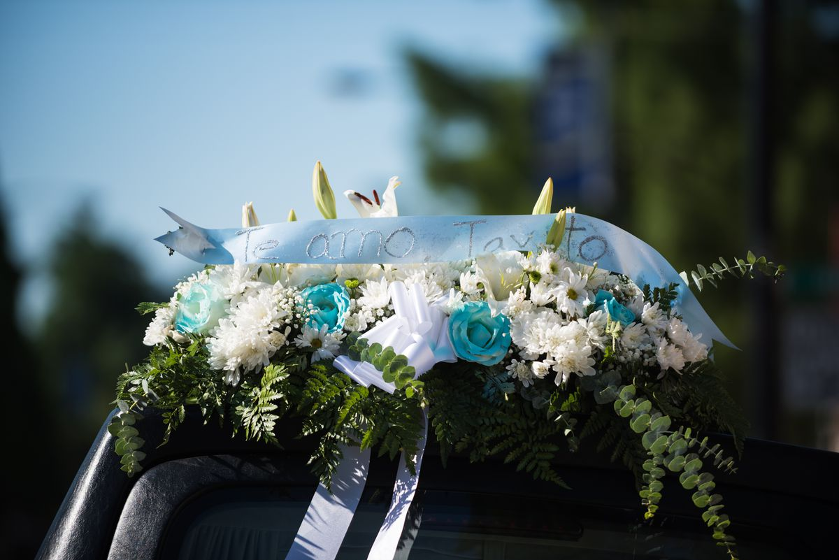 A bouquet of flowers for 10-year-old Gustavo Garcia sits on top of the hearse outside Immaculate Conception Church on Tuesday. | Max Herman/For The Sun-Times