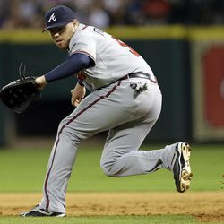 Atlanta Braves first baseman Freddie Freeman fields a ground ball hit by Houston Astros' Jason Castro during the sixth inning of a baseball game onWednesday, April 11, 2012, in Houston. Castro was out at first on the play.