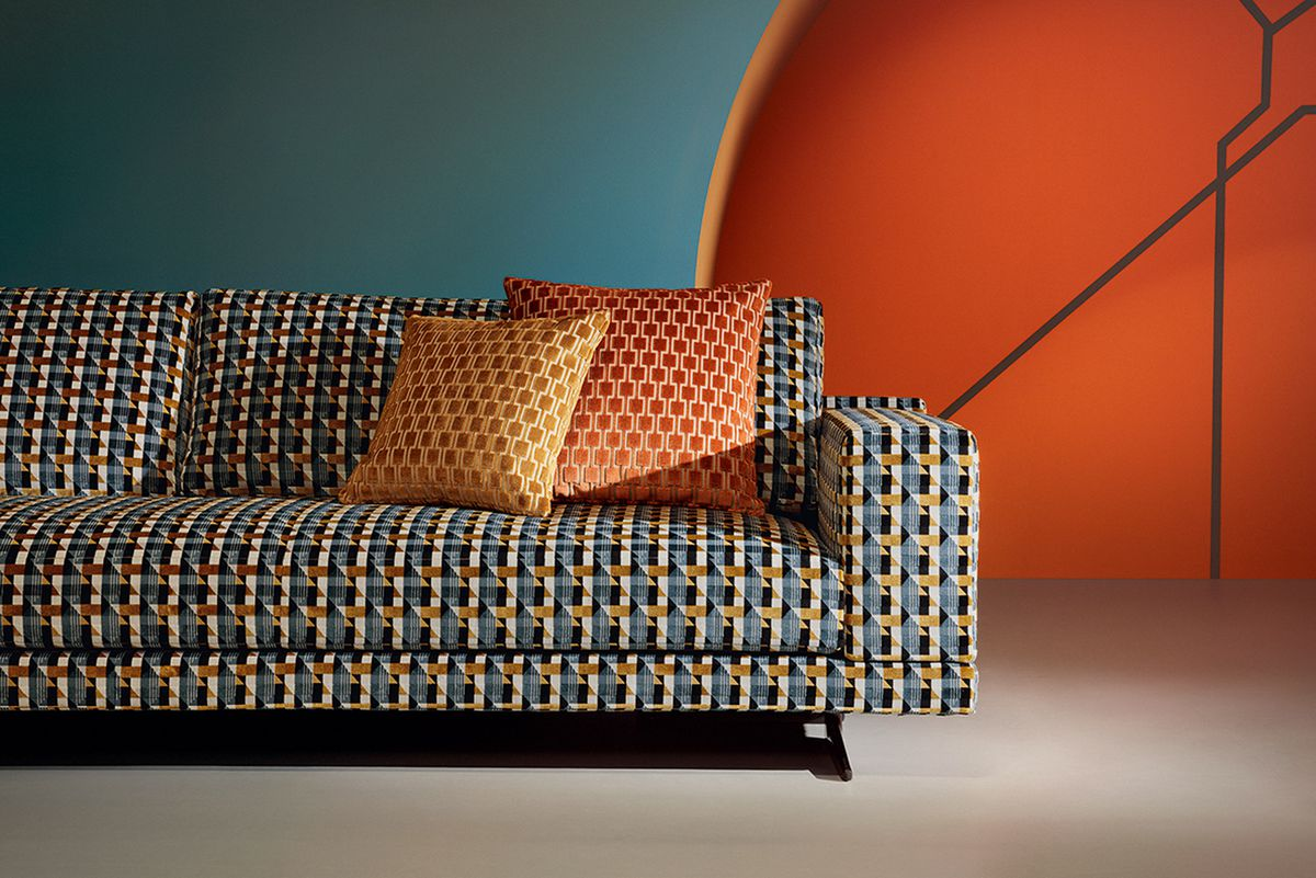 Couch upholstered in bold pattern.