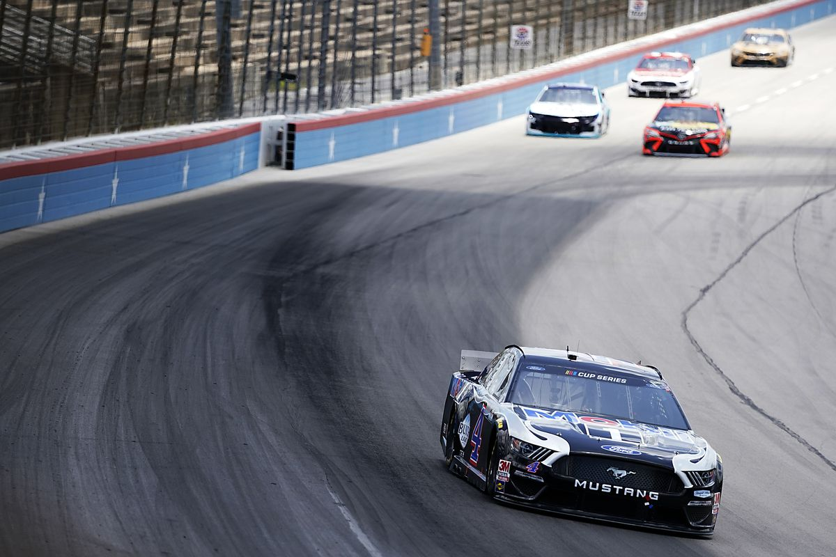 Kevin Harvick, driver of the #4 Mobil 1 Ford, leads a pack of cars during the NASCAR Cup Series O'Reilly Auto Parts 500 at Texas Motor Speedway on July 19, 2020 in Fort Worth, Texas.