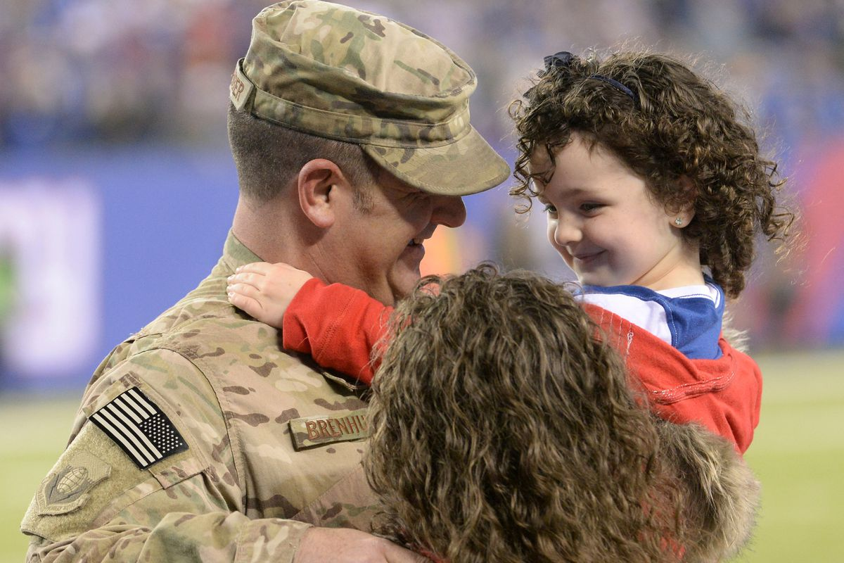 Air Force tech sgt David Brenhuber (Joint Base McGuire-Dix-Lakehurst) surprises his wifeTammy and 4-year-old daughter Alexis during Sunday's game at MetLife Stadium. Sgt Brenhuber just returned from Bagram Airfield, Afghanistan.