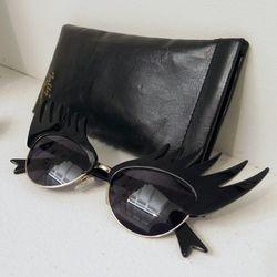"Too-cute sunnies from UK accessories brand <a href=""www.tattydevine.com/"">Tatty Devine</a>"