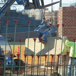 Concrete barricade, used for bracing the wall, being removed from the field -