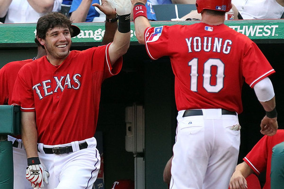 ARLINGTON, TX - JULY 01:  Michael Young #10 of the Texas Rangers celebrates a run with Ian Kinsler #5 against the Florida Marlins at Rangers Ballpark in Arlington on July 1, 2011 in Arlington, Texas.  (Photo by Ronald Martinez/Getty Images)