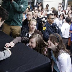 """""""American Idol's"""" David Archuleta signs a fan's cell phone during a stop at The Gateway in Salt Lake City Friday."""