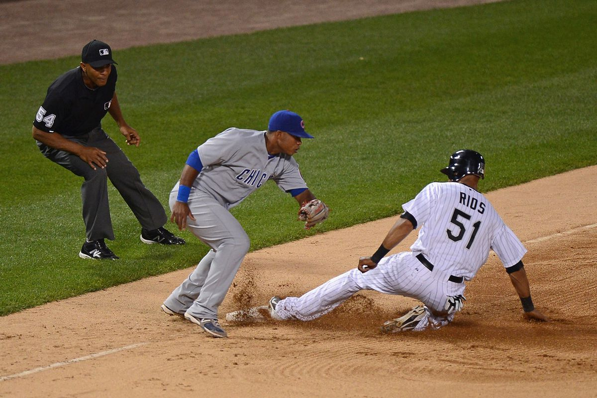 Alex Rios might be breaking an unwritten rule in this picture. It's hard to be sure.