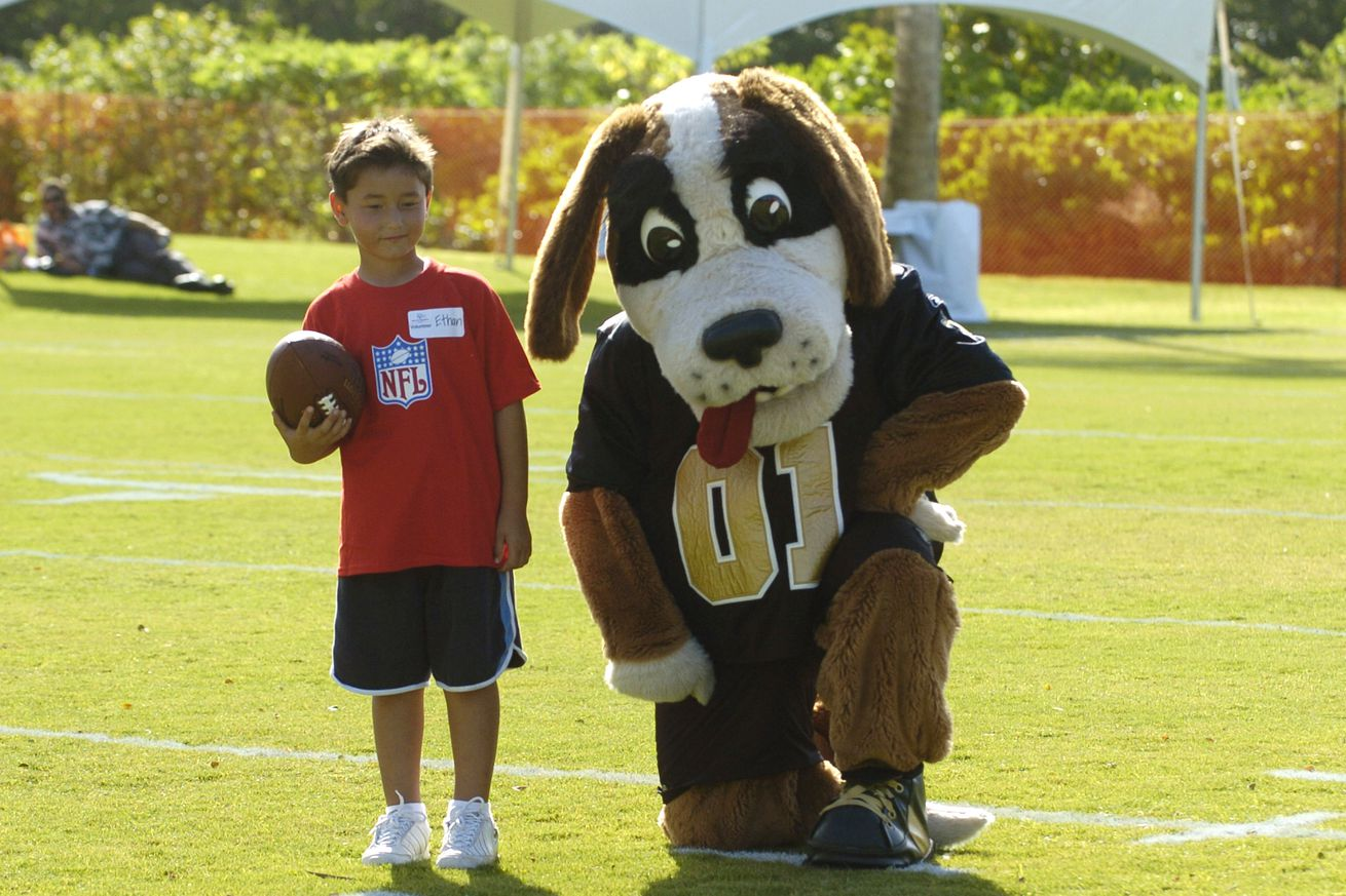 HONOLULU, HI - The New Orleans Saints mascot, Gumbo, poses with a competitor in the 2006 Special Olympics.