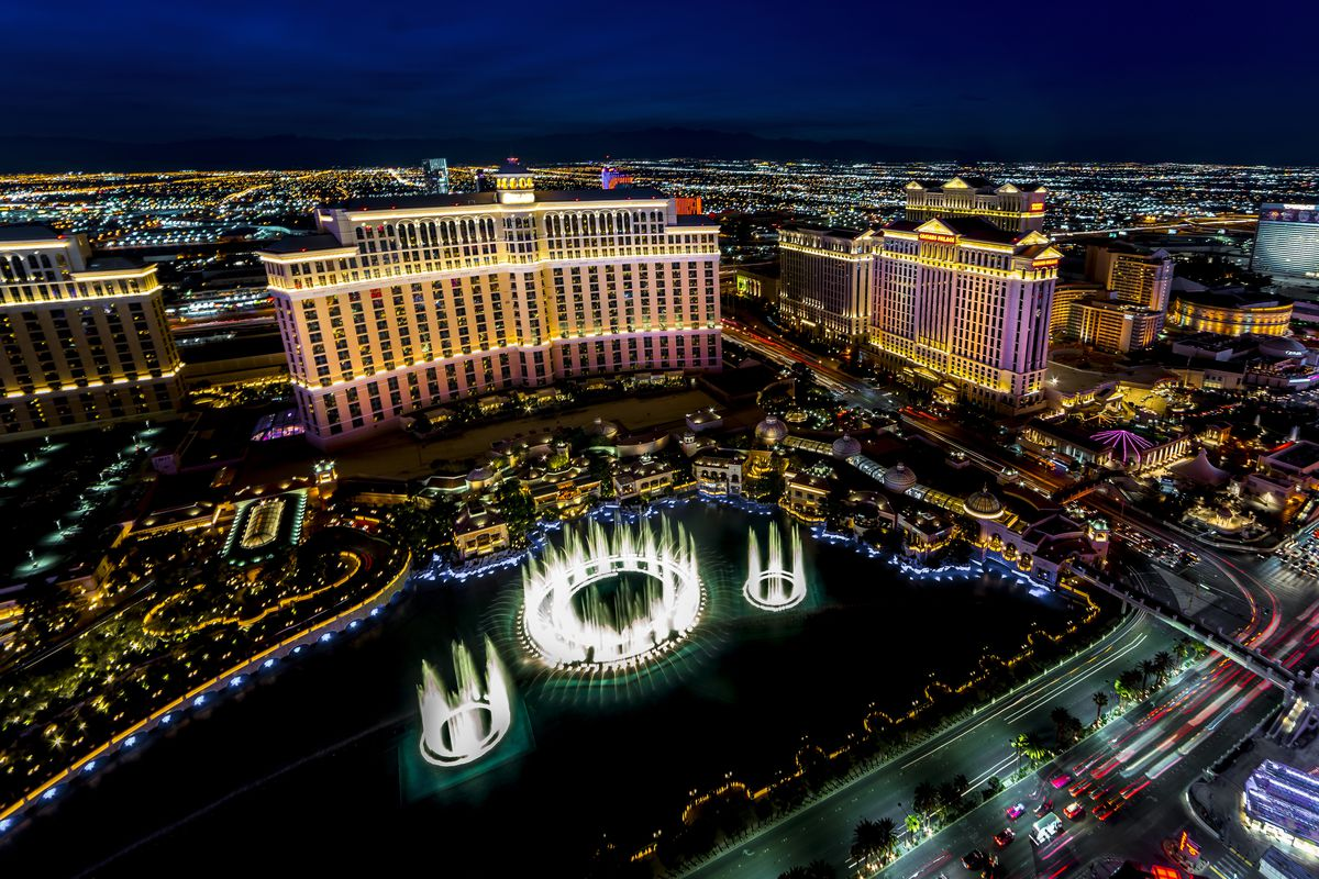 Panoramic View of Las Vegas Nevada at night with neon from Paris Eifel Tower view spot