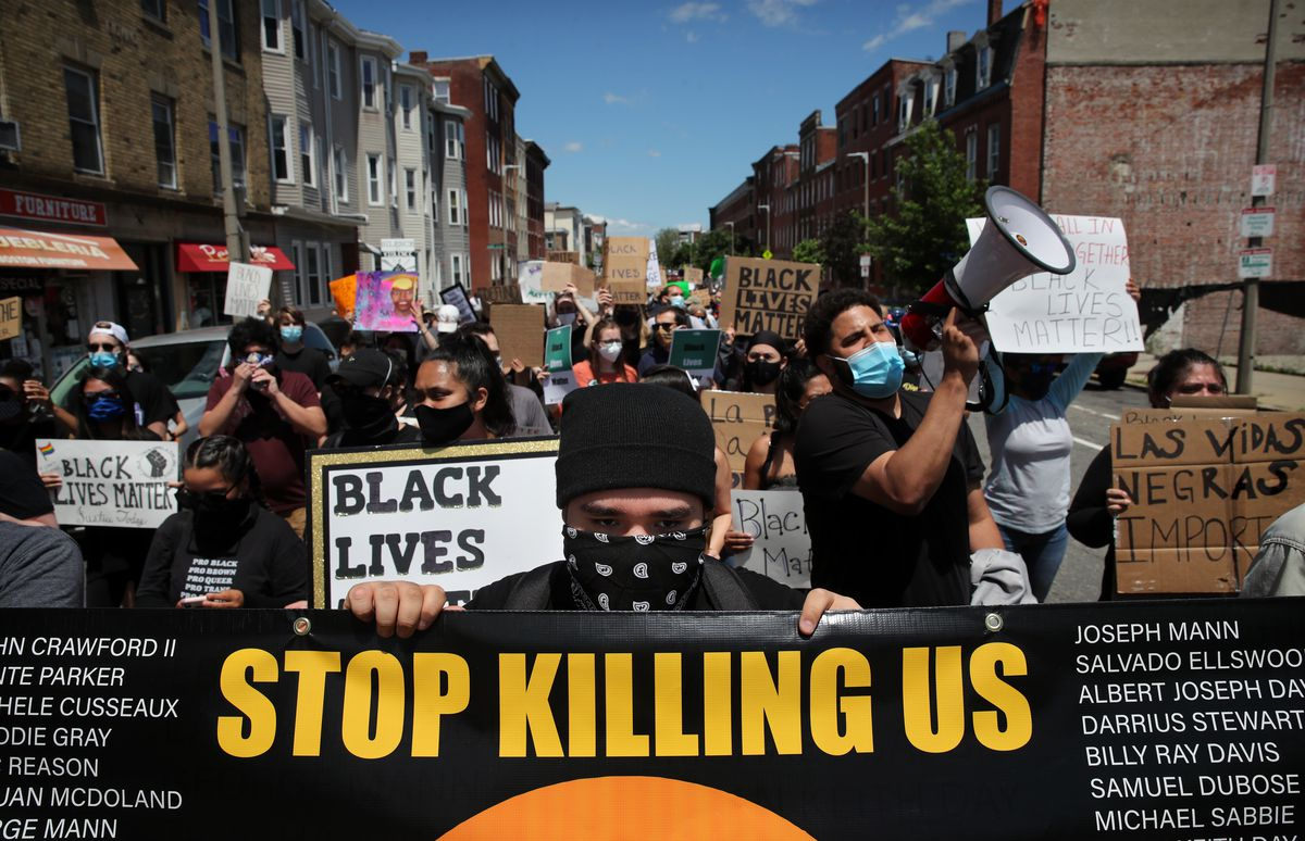 Demonstrators march during a Black Lives Matters protest in Boston