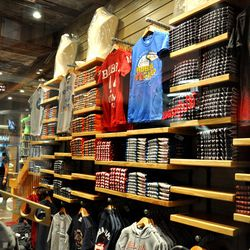 The gift shop is laden with souvenir shirts and gifts.