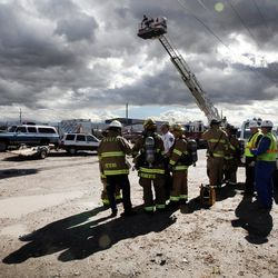 West Valley City firefighters respond to a junkyard fire at 5600 West and 2300 South on Monday, Oct. 17, 2016.