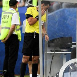 Colombian referee Wilmar Roldan watches a monitor next to the pitch, during the Confederations Cup, Group B soccer match between Germany and Cameroon, at the Fisht Stadium in Sochi, Russia, Sunday, June 25, 2017.
