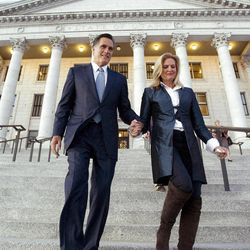 Mitt Romney and his wife Ann walk down the front steps to the State Capitol Thursday, Feb. 17, 2011 after attending a brief reception in the Gold room.